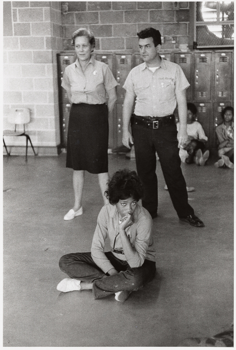 A woman sits to protest racial discrimination in schools, Birmingham, Alabama, USA