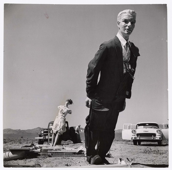 [Scorched male mannequin clad in dark business suit standing in desert 7,000 ft. from the 44th nuclear test explosion, a day after the blast, indicating that humans could be burnt but still alive, Yucca Flat, Nevada]