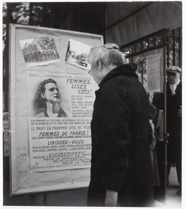 A Parisienne scans a poster outside Communist Headquarters in the Paris 14th arrondissement. Poster comes out strongly against hunger