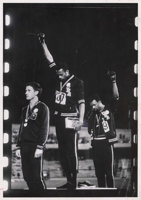 [American athletes Tommie Smith and John Carlos protesting racial inequity with raised fists during national anthem at Olympics, Mexico City]