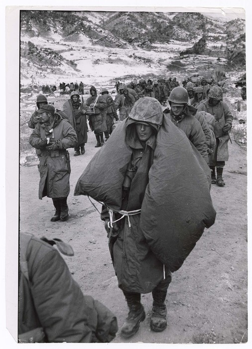 Some of the Marines on the march down the alley, plodding along with sleeping bags wrapped around them in an attempt to get a little warmer - futile. Everyone walked who wasn't wounded or frozen-footed.