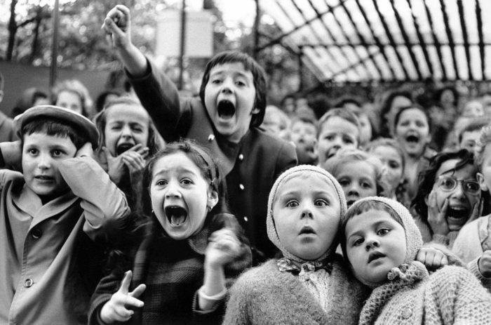 Expression of children at Paris Puppet Theater the moment the Bad Dragon was killed, the Tuileries Garden, Paris
