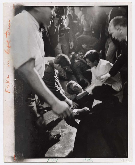 [Juan Romero, busboy at Ambassador Hotel, and others kneeling to help fallen Robert F. Kennedy after he was shot by Sirhan B. Sirhan, Los Angeles]