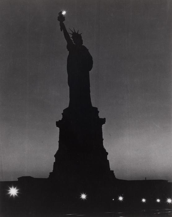 [Statue of Liberty at night]