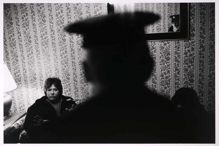 Woman with shadow of policeman