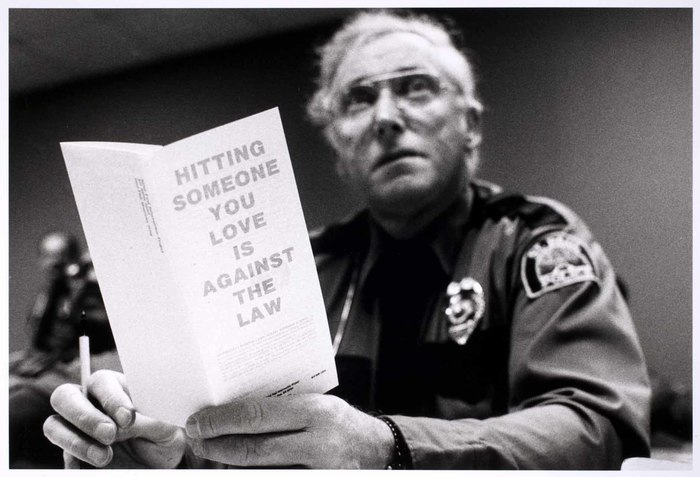 Policeman with pamphlet