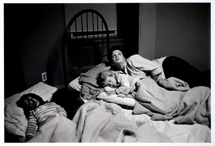 Woman with babies in shelter/bed
