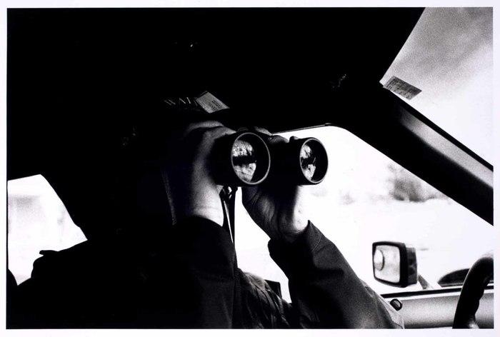 Policeman with binoculars