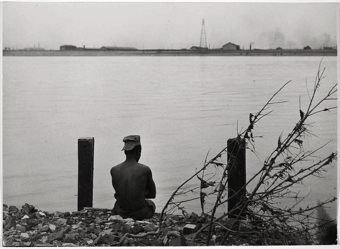 St. Louis, man sitting by River