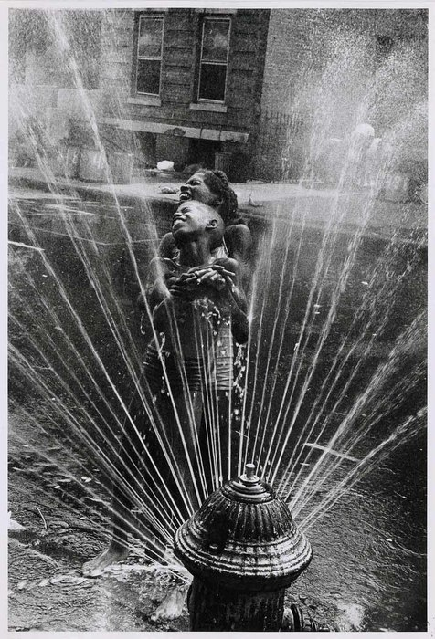The fire hydrants are opended during the summer heat, Harlem, NY, USA