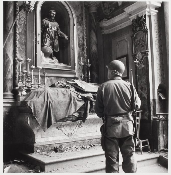 [American soldier in bombed church in World War II, Italy]