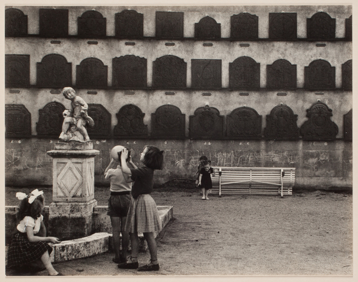 [Children playing playing in a courtyard]