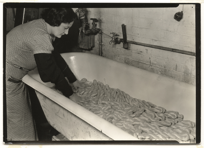 [Worker soaking silk skeins in boiled water to free it of gum, Madison Silk Company in Barnert Mills, Paterson, New Jersey]