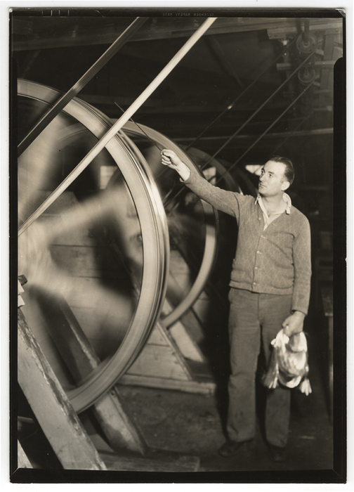 [Worker drawing glass on wheel, Frederick and Dimmock Company, Millville, New Jersey]