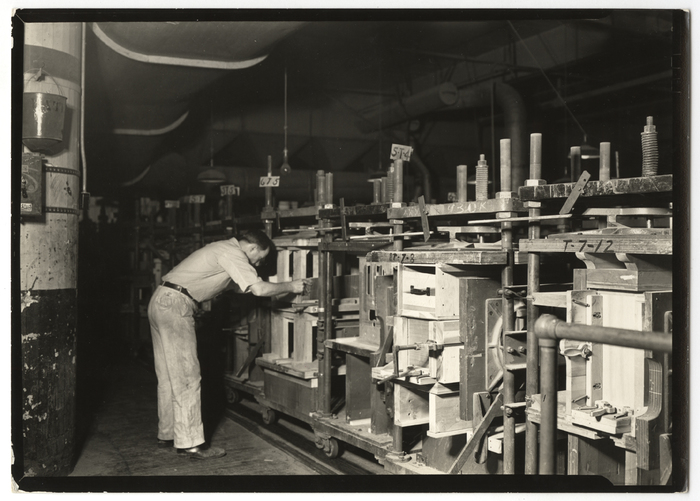 [Skilled cabinet maker assembling two key rails for radio cabinet, RCA Victor Plant, Camden, New Jersey]