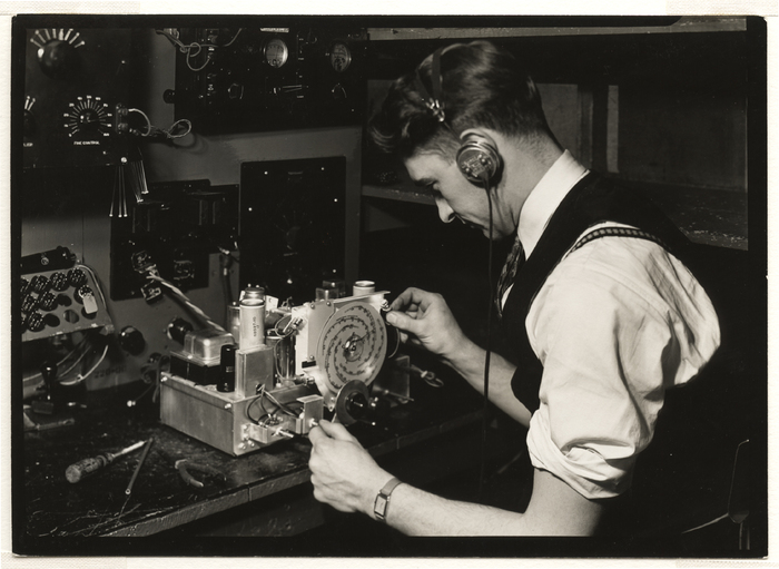 [Highly-skilled worker testing radio frequency alignment and making final test of chassis, RCA Victor, camden, New Jersey]
