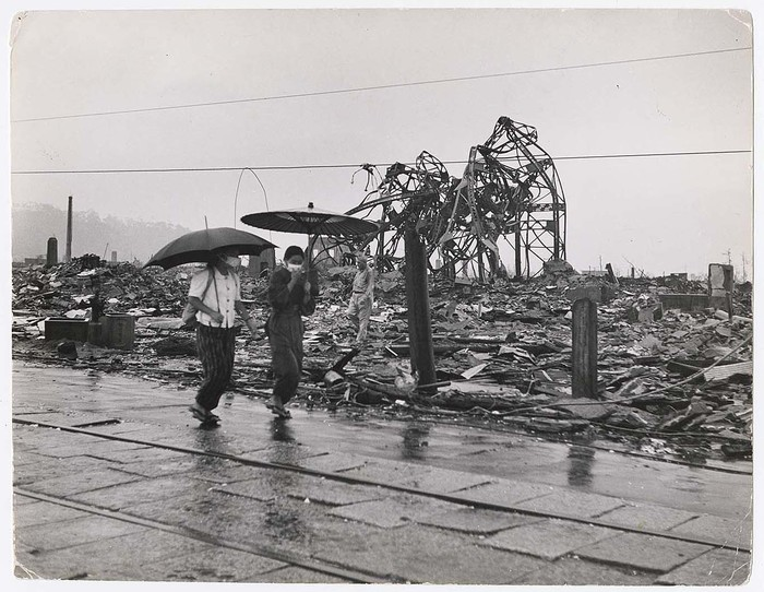 [People walking through the ruins of Hiroshima in the weeks following the atomic bomb blast]
