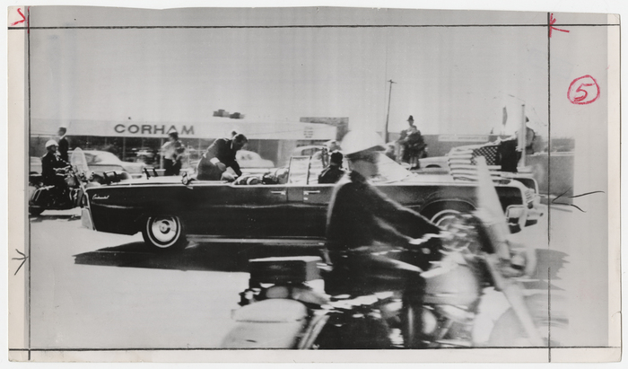 [John F. Kennedy's foot extending over side of presidential limousine after being hit with assassin's bullet, Dallas]