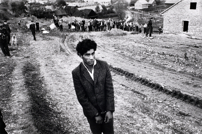 Reconstruction of a homicide. In the foreground: a young gypsy suspected of being guilty, Jarabina, Slovakia