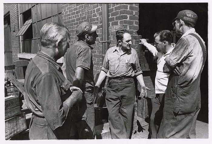 [Shop steward John Lombardo (c) for Local 77-A of Textile Workers Union getting details from machinist Rapacioli (r), foreman Miller (2R) and two workers complaining about new job at the American Lead Pencil Company]