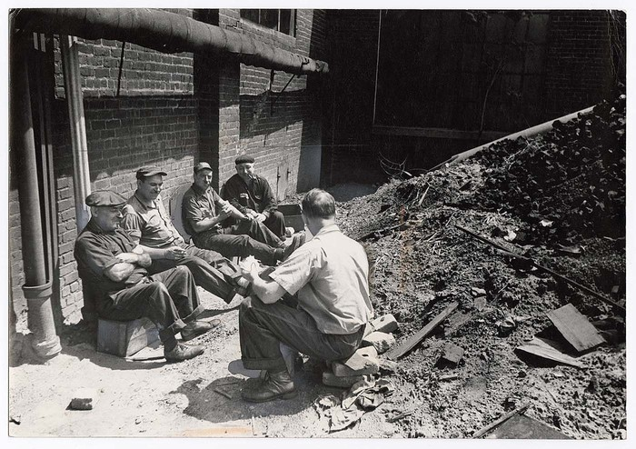 [Workers, who have no indoor lunchroom, eating outside American Lead Pencil Company]