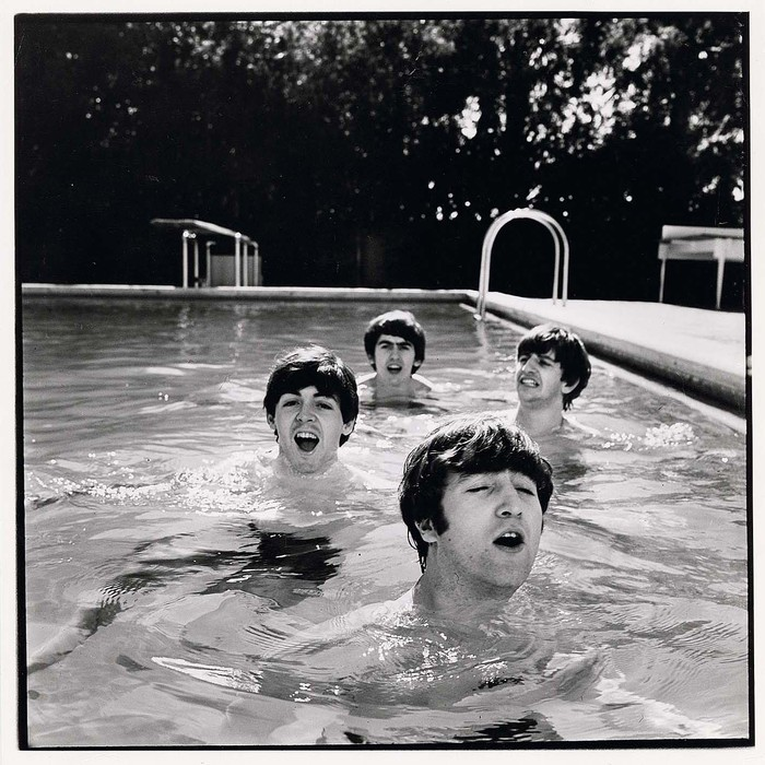 [L-R Paul McCartney, George Harrison, John Lennon and Ringo Starr of the Beatles, taking a dip in a swimming pool]