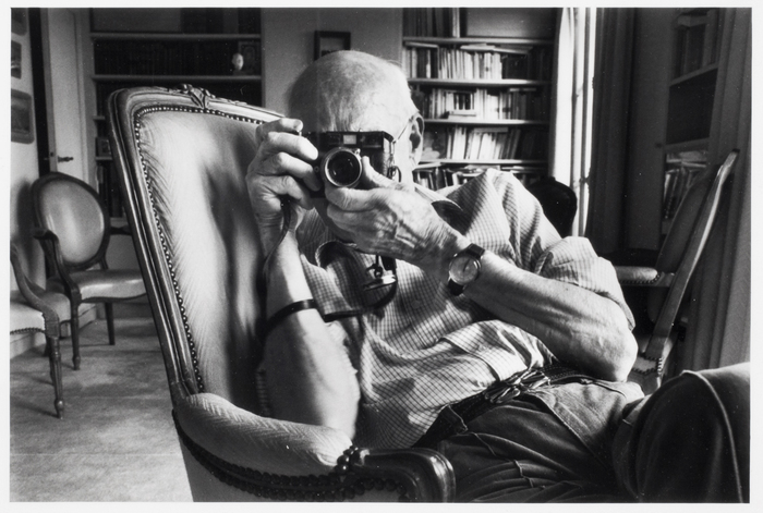 Cartier-Bresson takes pictures in his Paris apartment