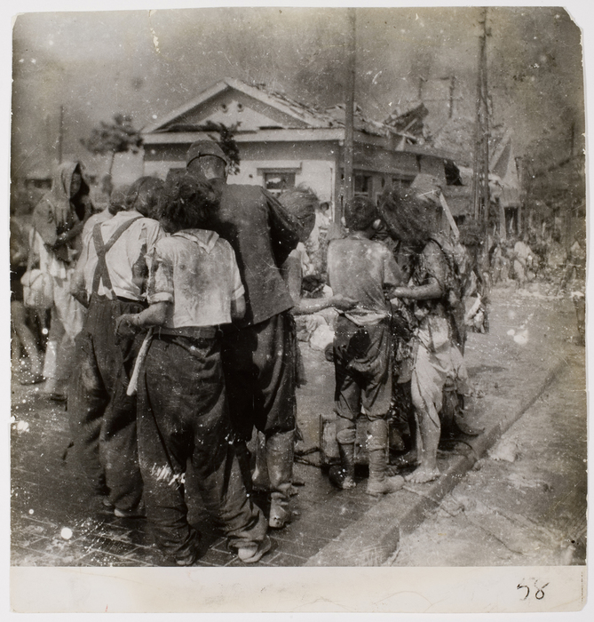 [Dazed survivors huddle together in the street ten minutes after the atomic bomb was dropped on their city, Hiroshima]