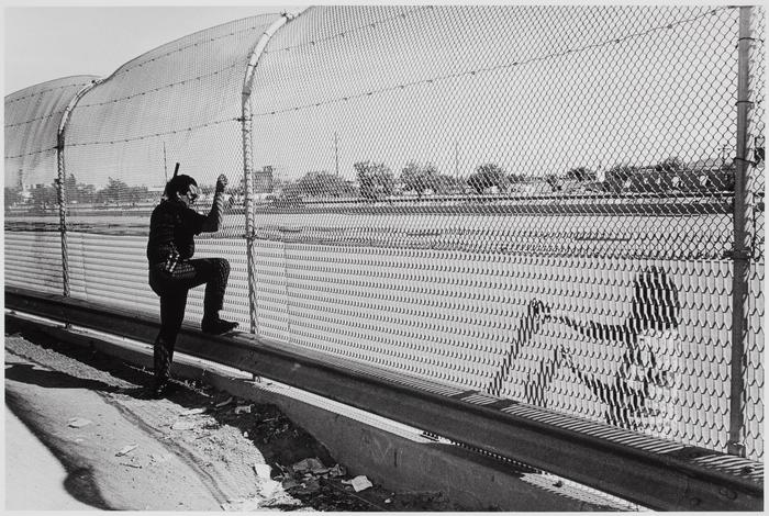Mexico, U.S. side of the border at El paso, Texas; behind the undocumented person is the Rio Grande and Ciudad Juárez