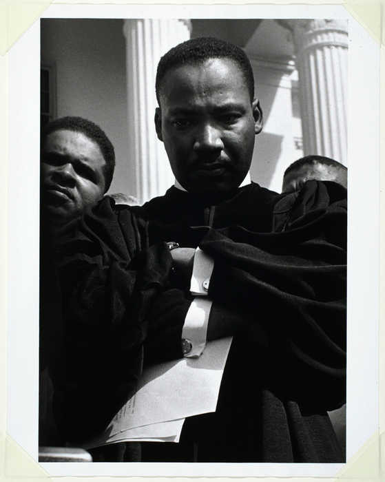 """Martin Luther King, Jr. addresses demonstrators on the steps of the state  capitol in Montgomery. In one speech, he said """"...let us move on in these  POWERFUL days of challenge to ... 