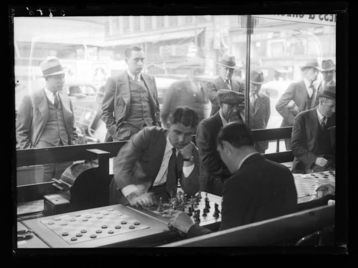 [Men playing chess]