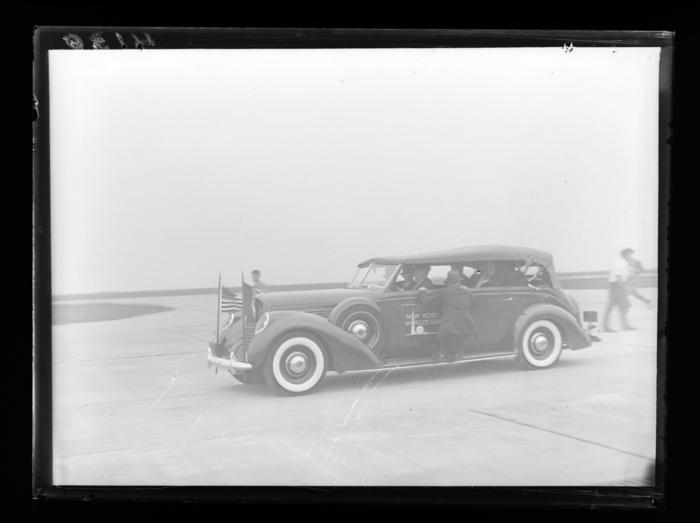 Howard Hughes in car on runway, Floyd Bennett Field, Brooklyn ...