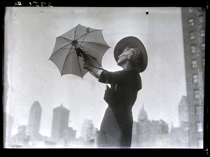 Woman With Umbrella On Rooftop New York International Center Of