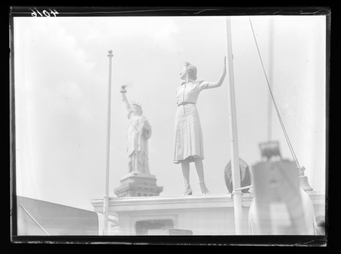 [Woman in front of Statue of Liberty, New York]