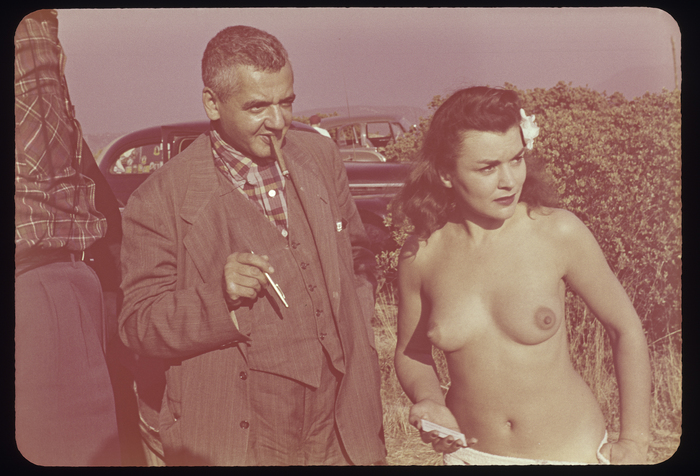 [Weegee and nude model in desert, Southern California]