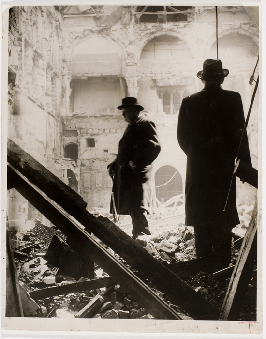 Prime Minister, Winston Churchill, looking at the bombed out remains of the Debating Chamber in the House of Commons following Germans attack. (Famous Picture File)