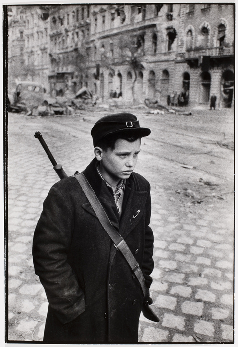 On a man's mission, Pal Pruck, 15, was one of the many brave teen-agers who fought in the revolution. He is standing in a rubble-strewn Budapest street