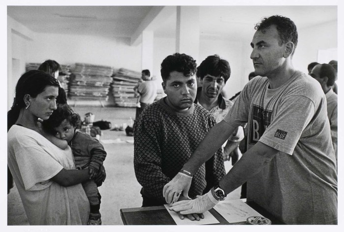 A Yugoslav Gypsy family, caught trying to enter Italy illegally, is processed by Italian authorities.