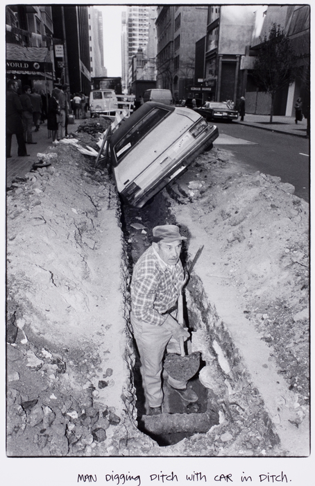 Man digging ditch with car in ditch | International Center of Photography