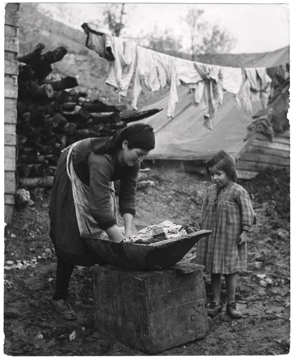[Woman washing laundry by hand, a girl watches, Ioannina, Greece]