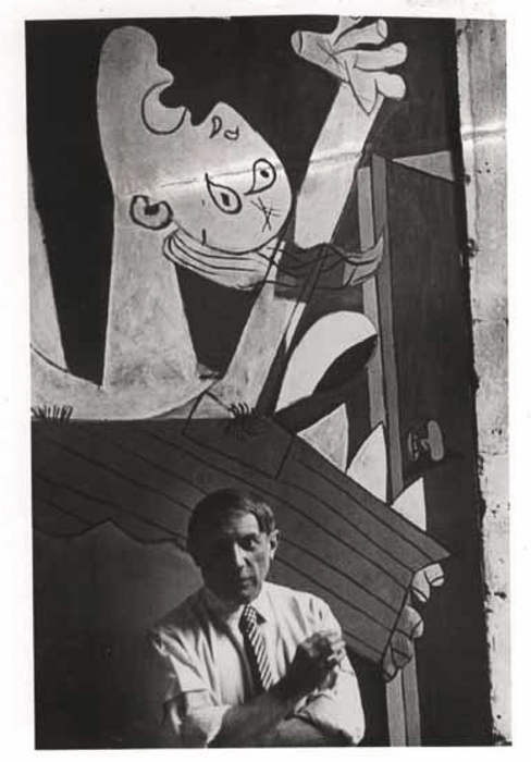 [Picasso in front of his painting, Guernica, in his studio, Paris]