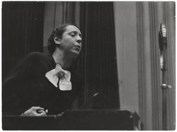 [Marguerita Nelkery, Spanish worker's deputy, addressing a meeting from a podium, Paris, France]