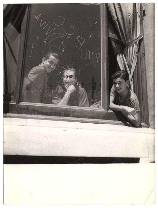 [Three men in the window of the Hotel Colón, headquarters of the PSUC (United Socialist Party of Catalonia), Barcelona]