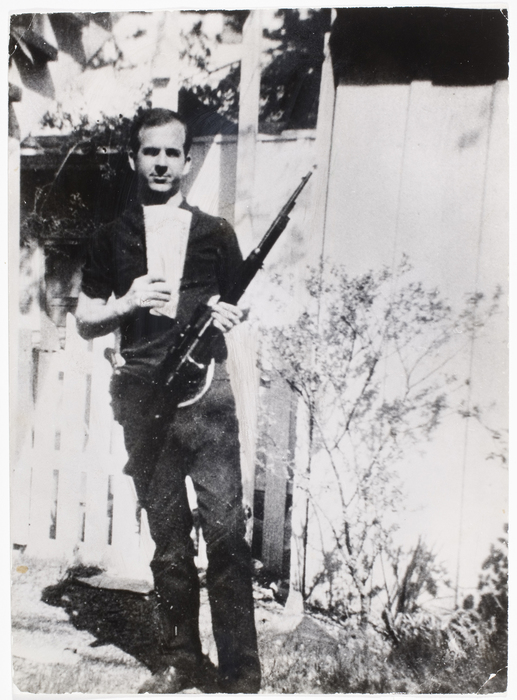 [Lee Harvey Oswald standing outside his home holding a rifle, Dallas]
