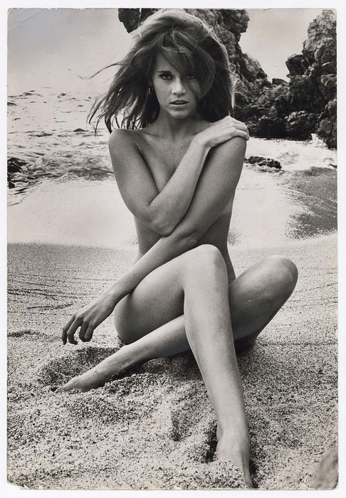 Fonda Revealed: Wild as the sea and the rocks behind her, Jane Fonda poses daringly on the beach.