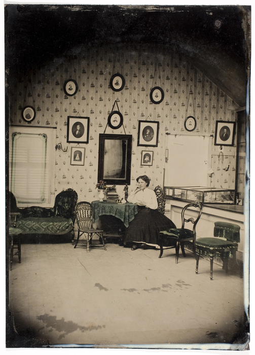 [Unidentified Woman in Parlor of Photo Studio]