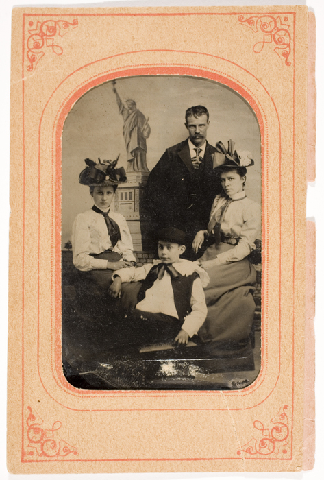 [Unidentified Family Group with Statue of Liberty]