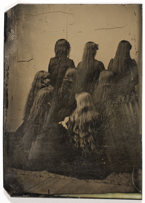 [Backs of Eight Unidentified Women with Long Hair]