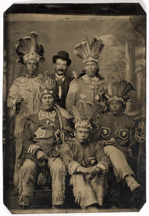 [Unidentified Man Posing with Five Men in Native American Dress]