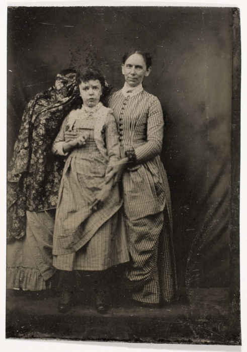 [Unidentified Invalid Girl with Woman and Cloaked Attendant]